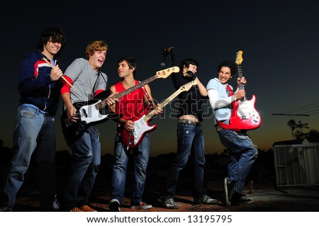 Group of trendy teenagers with musical instruments