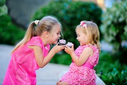 group of two children cute fashion little girls eat happy birthday pink cupcake