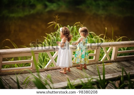 Group of two cute little flower girl in the beautiful garden