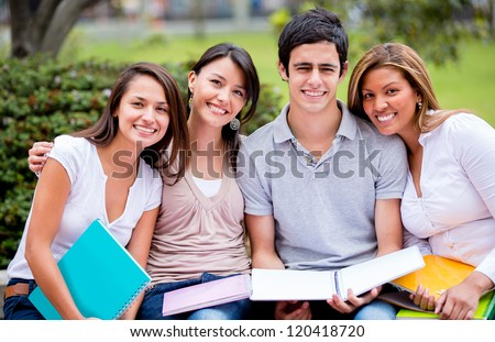 Group of university students outdoors looking happy