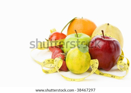 Group of various fruits with measuring tape over white background