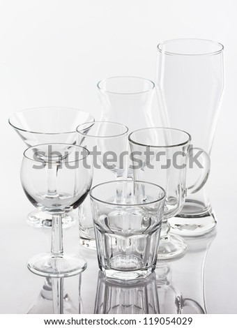 Group of various glasses on white background
