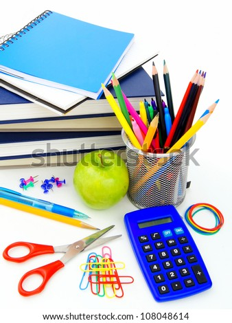 Group of various school supplies and items over a white background