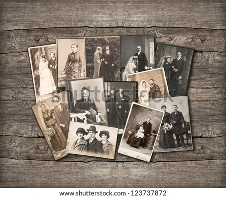group of vintage family and wedding photos circa 1890-1920 nostalgic sentimental pictures on rustic wooden background
