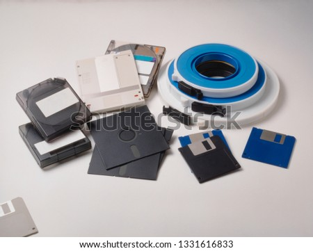 group of vintage media storage, floppy disks, syquest drive and magnetic tape