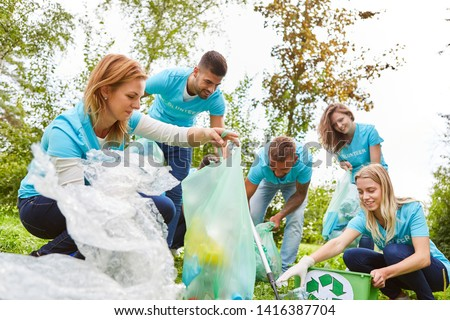 Group of volunteer environmentalists collects waste in a conservation project Stock foto ©