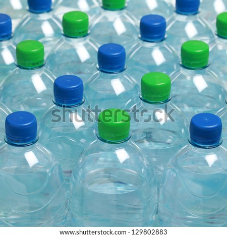 Group of water in plastic bottles, shallow depth of field - stock photo