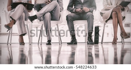 Group of well dressed business people waiting in waiting room