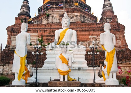 Group of white buddha statue with pagoda in Ayutthaya province, Thailand.
