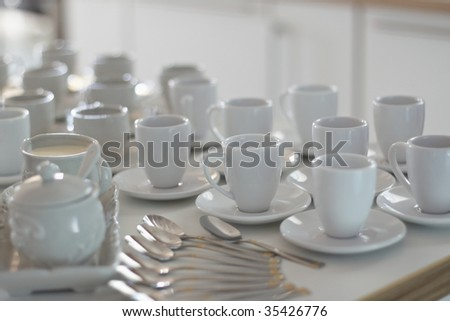 group of white coffee cups