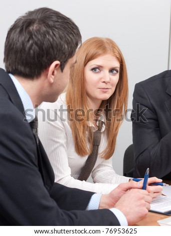 Group of white-collar workers on meeting in board room