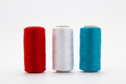 Group of whole haberdashery item colorful thread spools isolated on white background. Coloured threads. Colorful bobbin thread.