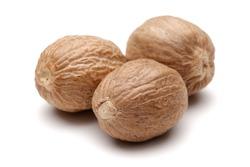 Group of whole nutmegs isolated on white background