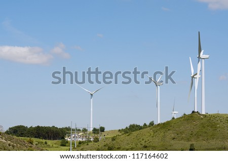group of windmills for renewable electric energy production on a hill, Aras, Navarre, Spain