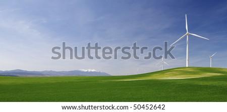 group of windmills in an idyllic green meadows