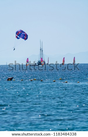 Group of windsurfers is Red sea near Eilat, Israel, water sport and recreation #1183484338