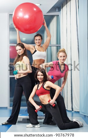 group of woman with dumbbells in gym at fitness physical training exercise in sport wear