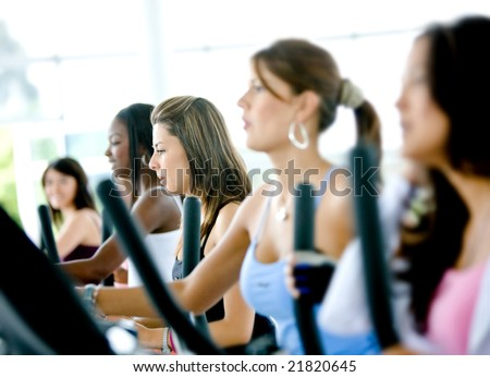 group of women doing cardio in a gym