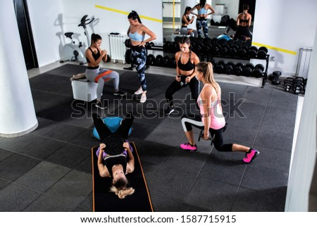 Group of women doing leg workouts in the gym