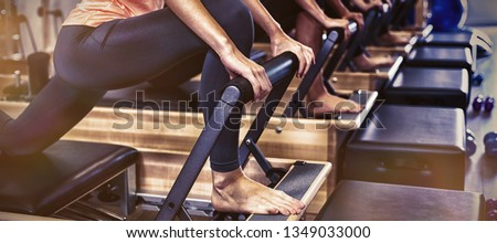Group of women exercising on reformer in gym Stockfoto ©