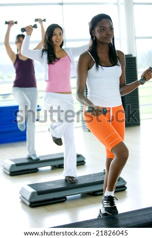 group of women in a steps class at the gym