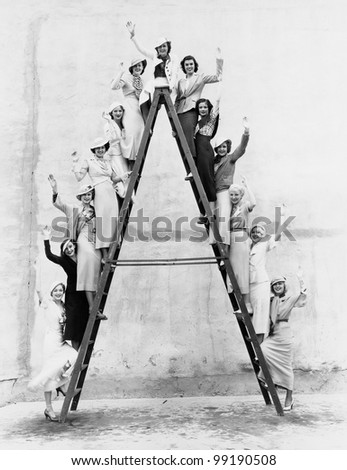Group of women on tall ladder