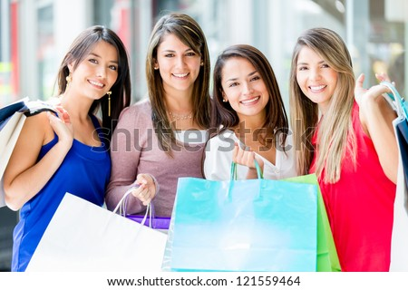 Group of women shopping at the mall looking happy