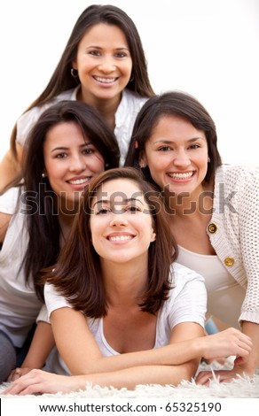 Group of women smiling - isolated over a white background