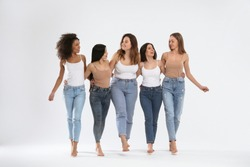 Group of women with different body types on light background