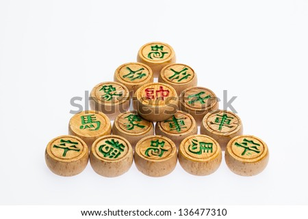 Group of wooden Chinese chess against white background