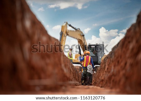 Group of worker and construction engineer wear safety uniform excavation water drainage at construction site #1163120776