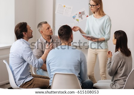 Group of workers discussing something actively #615108053