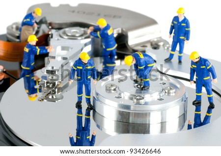Group of workers repairing HDD. Hard Drive repair concept