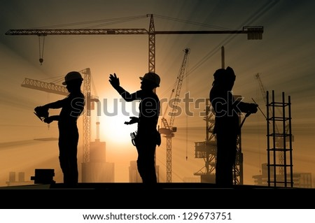 Group of workers talk among themselves.