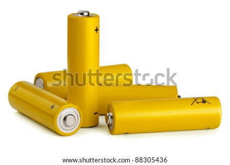 Group of yellow AA size batteries isolated on white