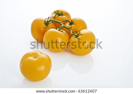 group of yellow tomatos isolated on white background