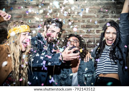 Group of young adults hanging around in a disco club #792143512