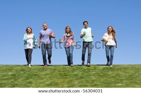 Group of Young Adults Playing Outdoors