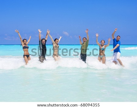 Group of young adults playing together in the ocean waves