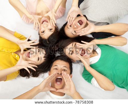 group of young asian people are shouting - stock photo