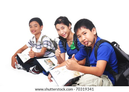 group of young asian students sitting on the floor. in white background.