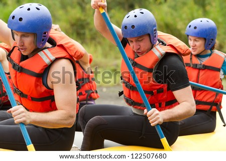 Group of young atheltes training for whitewate rafting