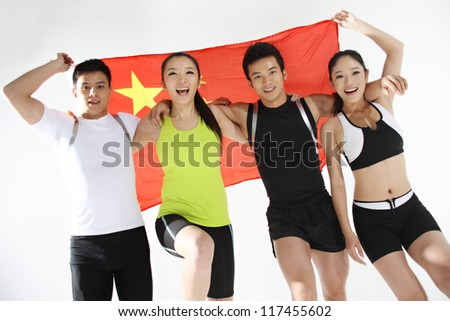 Group of young athletes holding China flag