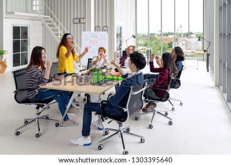 Group of young attractive asian creative design team meeting at office celebrating success or winner. Asian employee engaged together with effective and productive meeting and happy workplace concept. #1303395640