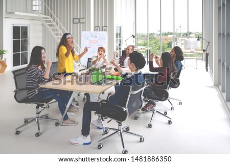Group of young attractive asian creative design team meeting at office celebrating success or winner. Asian employee engaged together with effective and productive meeting and happy workplace concept. #1481886350