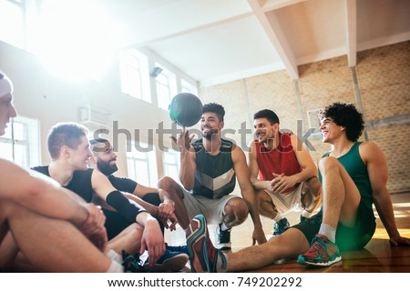 Group of young basketball players having fun with a ball