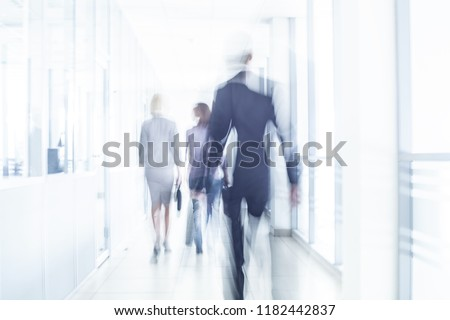 group of young business people are actively moving around the large office