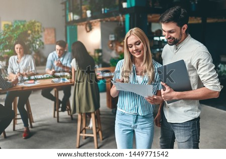 Group of young business people are working together in modern office. Creative people with laptop, tablet, smart phone, notebook. Successful hipster team in coworking. Freelancers. #1449771542