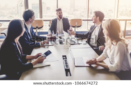 Group of young business people are working together in modern office with laptop, tablet, smart phone, notebook. Successful team in coworking. Freelancers. #1066674272