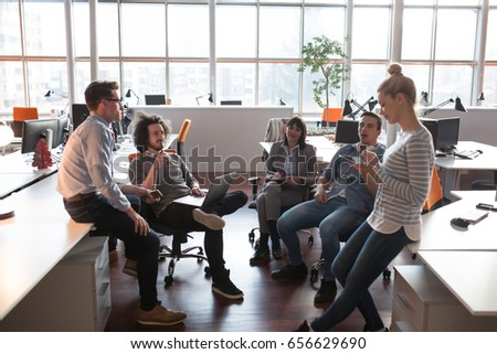 Group of young business people discussing business plan in the office #656629690